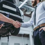 customer shaking hands with auto repair technician